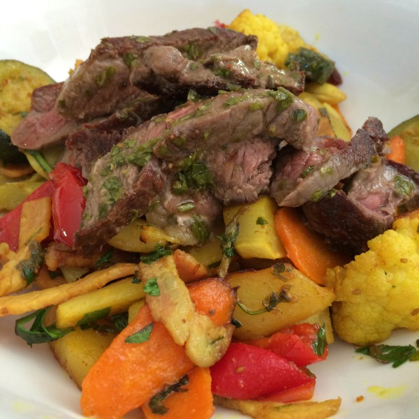 Roast vegetables with steak and chimichurri.